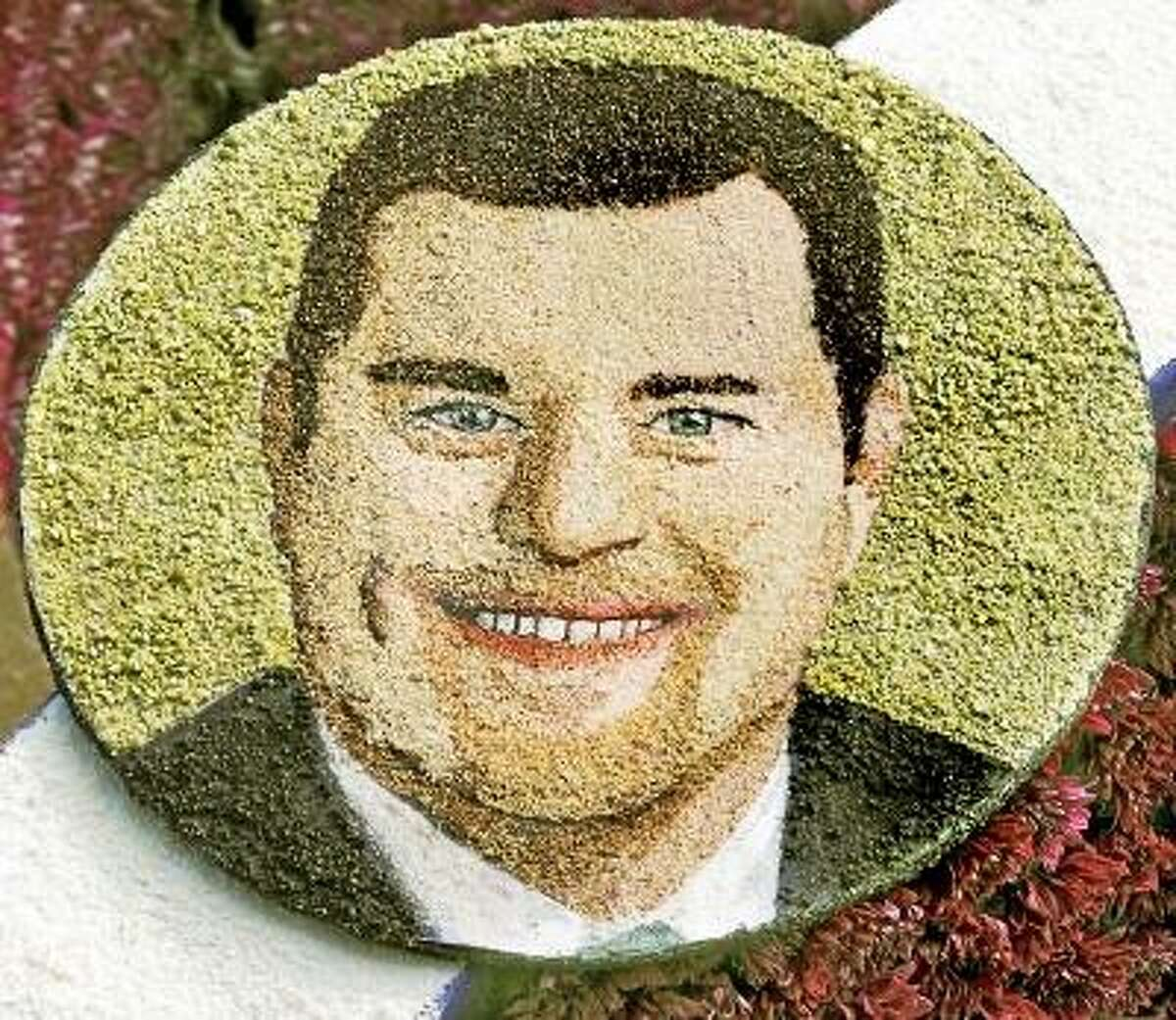 """A """"florograph"""" image of Robert Novak, a Deep River, CT, man who died and donated his tissue to save others, will adorn one of the floats in the Rose Parade. For the 32 people honorted to ride the 10th annual Donate Life float in the 2013 Rose Parade, their emotional journeys mirror the highs, low and all points in between shared by the national community of organ and tissue recipients, transplant candidates, living donors and families of deceased donors they represent. The 2013 Donate Life float will carry individuals aged 12 to 68 from 17 states and Canada who were selected by local organizations for their example of courage, hope, genorsity and advocavy for organ and tissue donation Monday, December 31, 2012. (SGVN/Photo by Walt Mancini/SXCity)"""