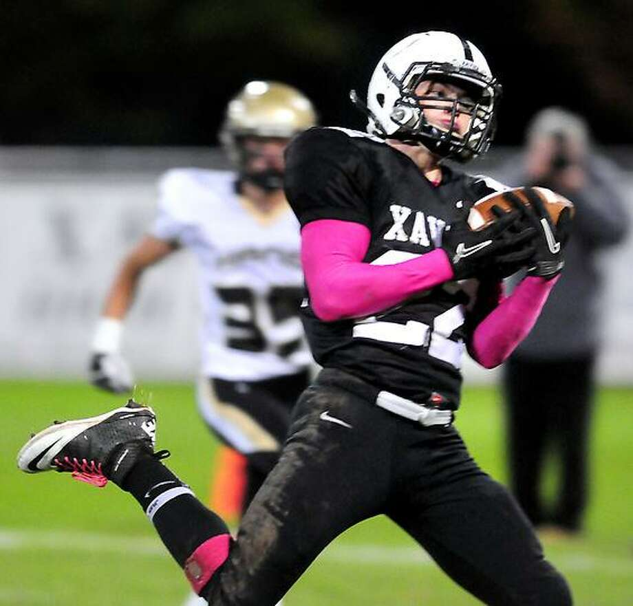 Kris Luster of Xavier makes a reception scoring against Daniel Hand in the first half at Palmer Field in Middletown on 10/12/2012.Photo by Arnold Gold/New Haven Register