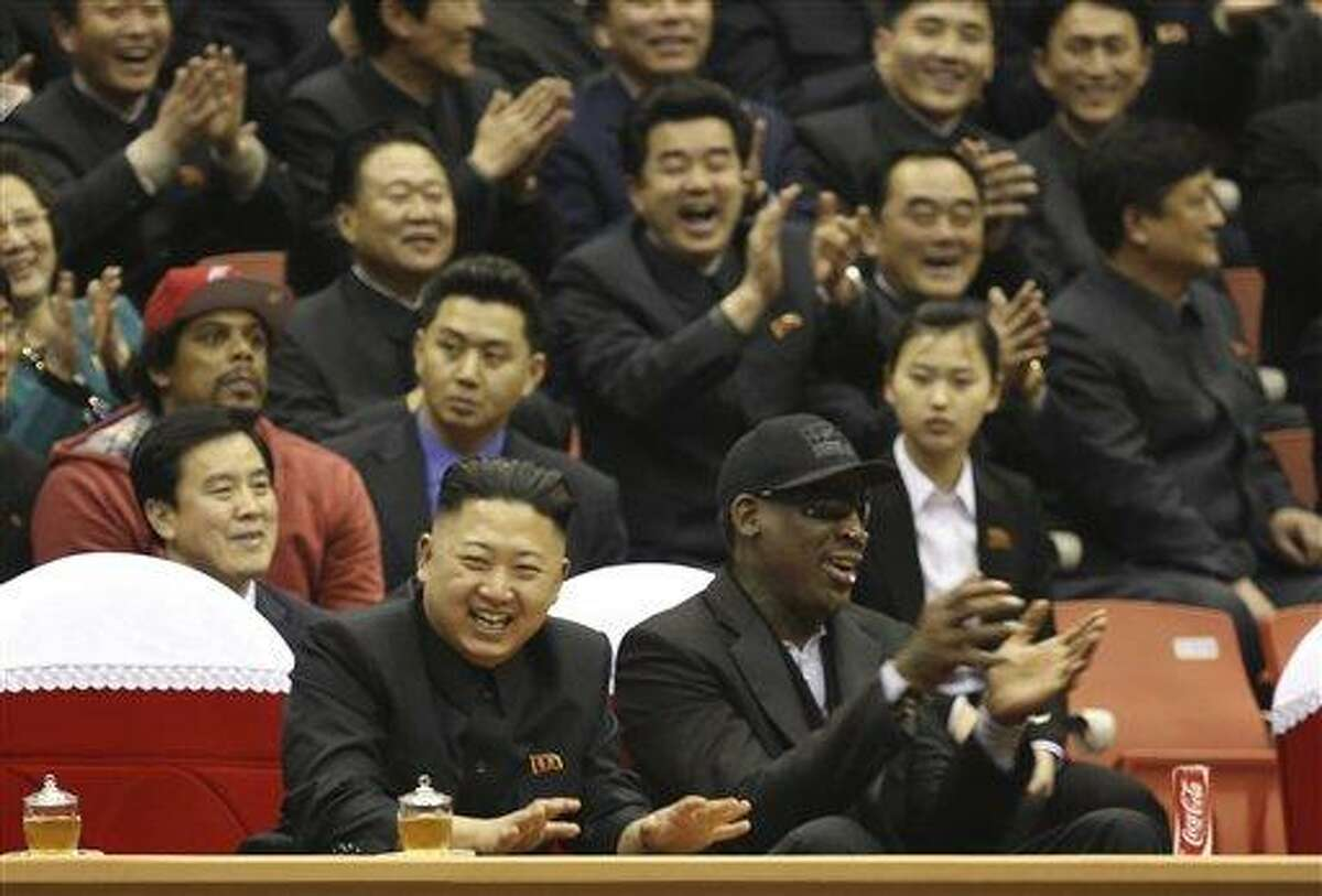 FILE - In this Thursday, Feb. 28, 2013 file photo released by VICE Media, North Korean leader Kim Jong Un, left, and former NBA star Dennis Rodman watch North Korean and U.S. players in an exhibition basketball game at an arena in Pyongyang, North Korea. Rodman is tapping his friendship with Kim Jong Un to call for the release of a Korean-American man detained in the North. In a tweet on Wednesday, May 8, 2013, Rodman called on Kim