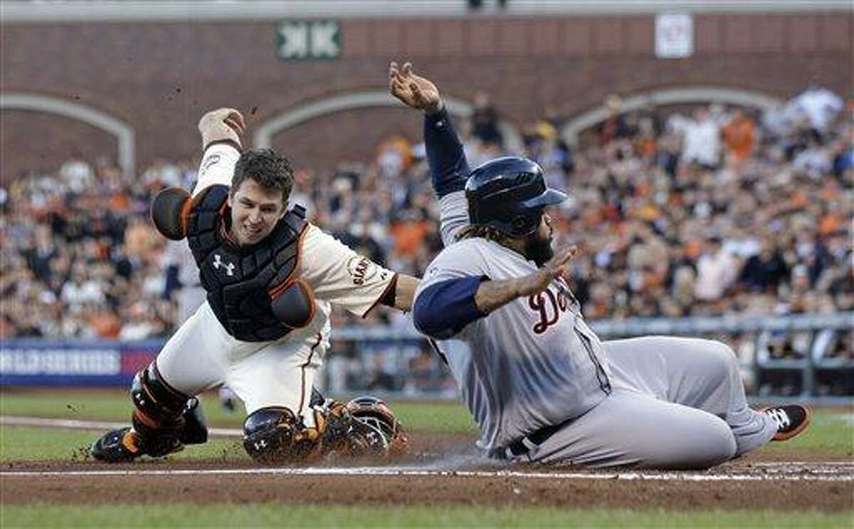 Detroit Tigers' Prince Fielder is tagged out at home plate by San Francisco Giants' Buster Posey during the second inning of Game 2 of baseball's World Series Thursday, Oct. 25, 2012, in San Francisco. (AP Photo/Marcio Jose Sanchez)