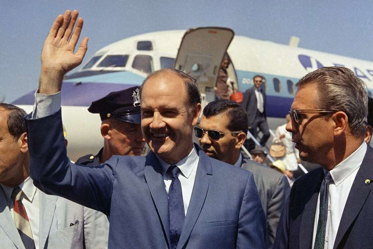 In this Aug. 12, 1968, file photo, Democratic presidential candidate Sen. George McGovern (D-SD.) waves on his arrival to New York. A family spokesman says, McGovern, the Democrat who lost to President Richard Nixon in 1972 in a historic landslide, has died at the age of 90. According to the spokesman, McGovern died Sunday, Oct. 21, 2012 at a hospice in Sioux Falls, surrounded by family and friends. (AP Photo/John Lindsay, File)