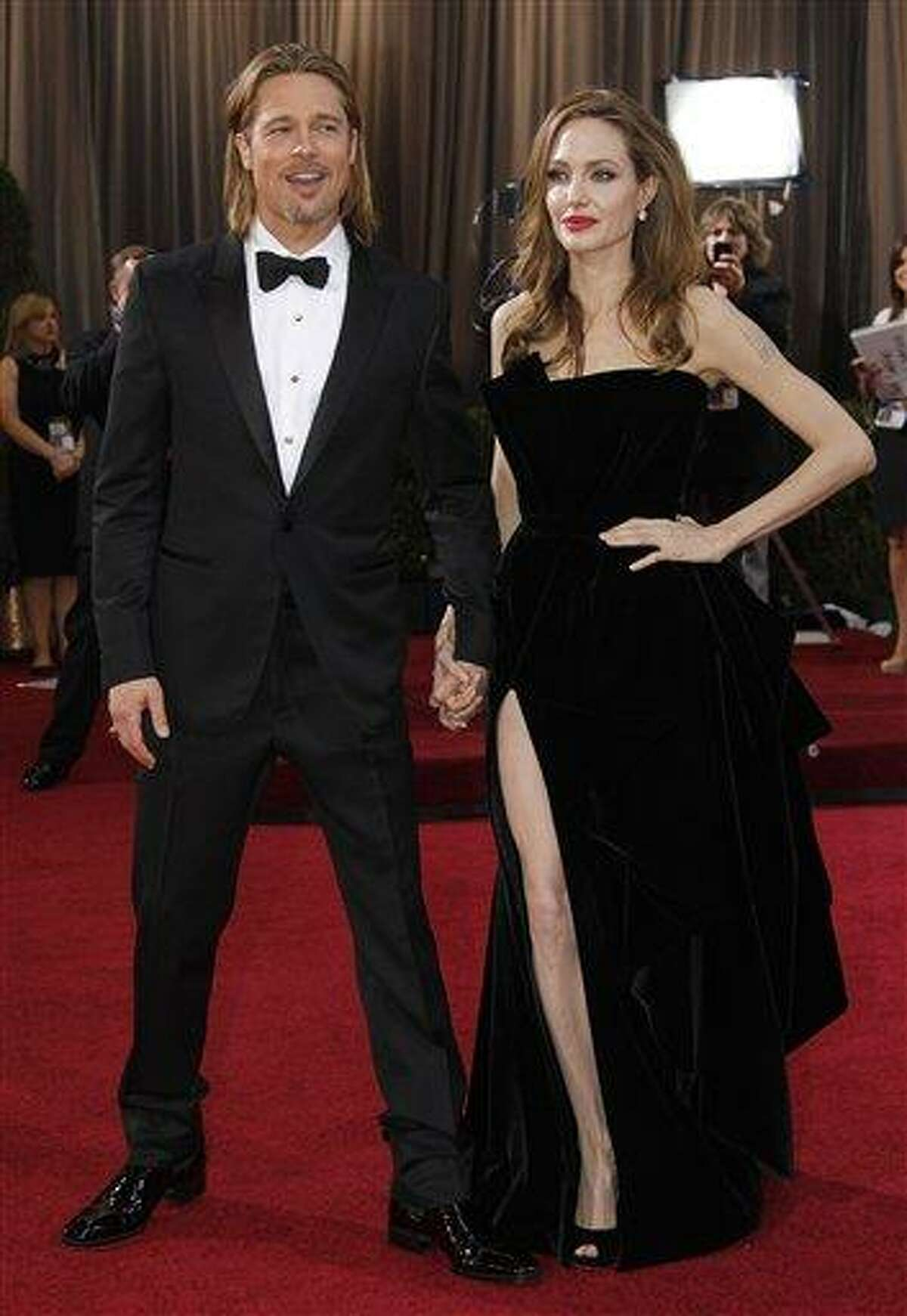 Actress Angelina Jolie, right, and actor Brad Pitt arrive before the 84th Academy Awards Sundayin the Hollywood section of Los Angeles. Associated Press