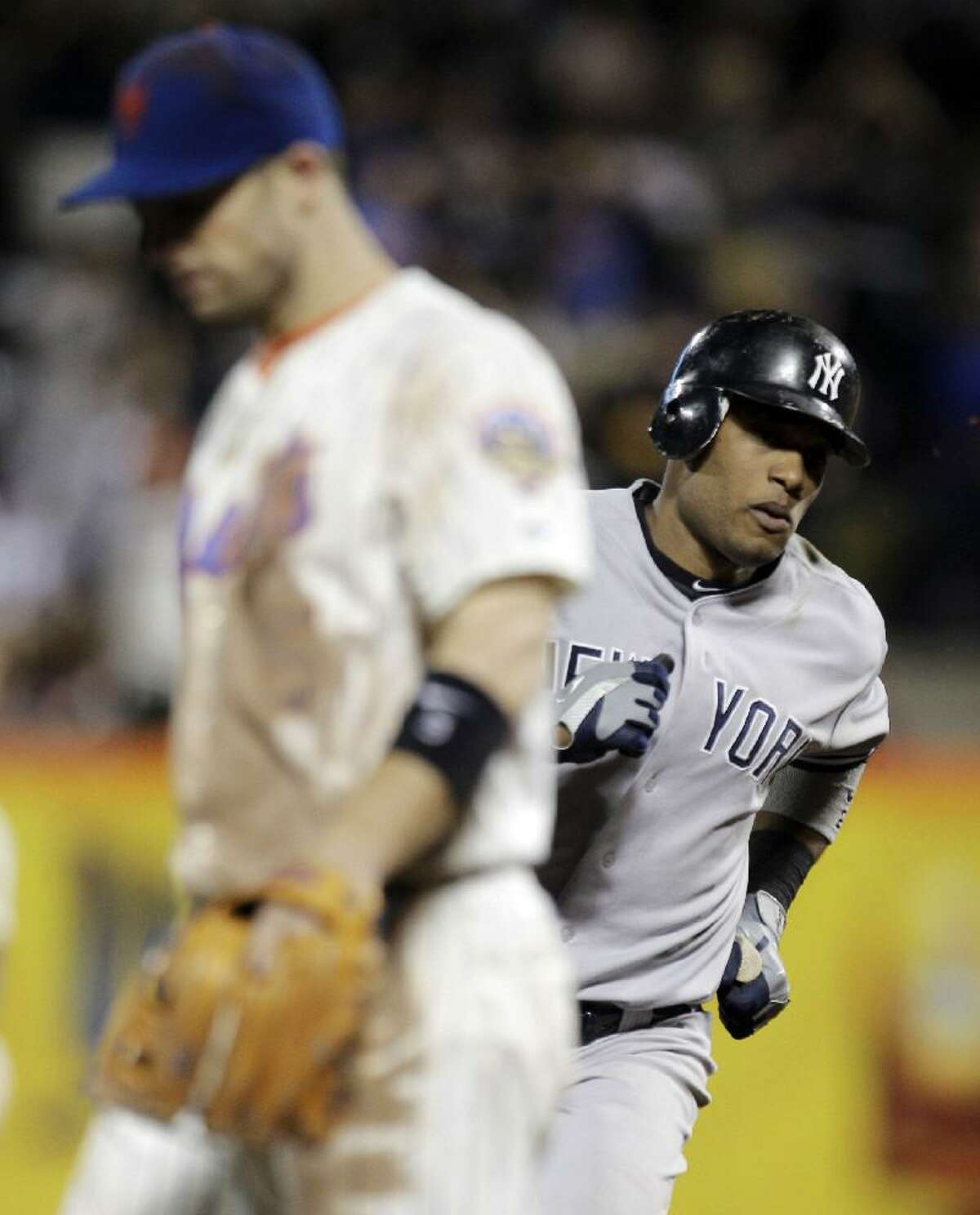 ASSOCIATED PRESS New York Yankees second baseman Robinson Cano, right, runs the bases past New York Mets third baseman David Wright after hitting a home run in the eighth inning of Sunday night's game at Citi Field in New York. The Yankees won 6-5.