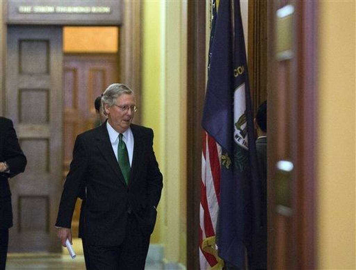 Senate Minority Leader Mitch McConnell of Kentucky departs the Strom Thurmond room after a Senate Republican caucus meeting about the fiscal cliff, on Capitol Hill, Monday. AP Photo/Alex Brandon