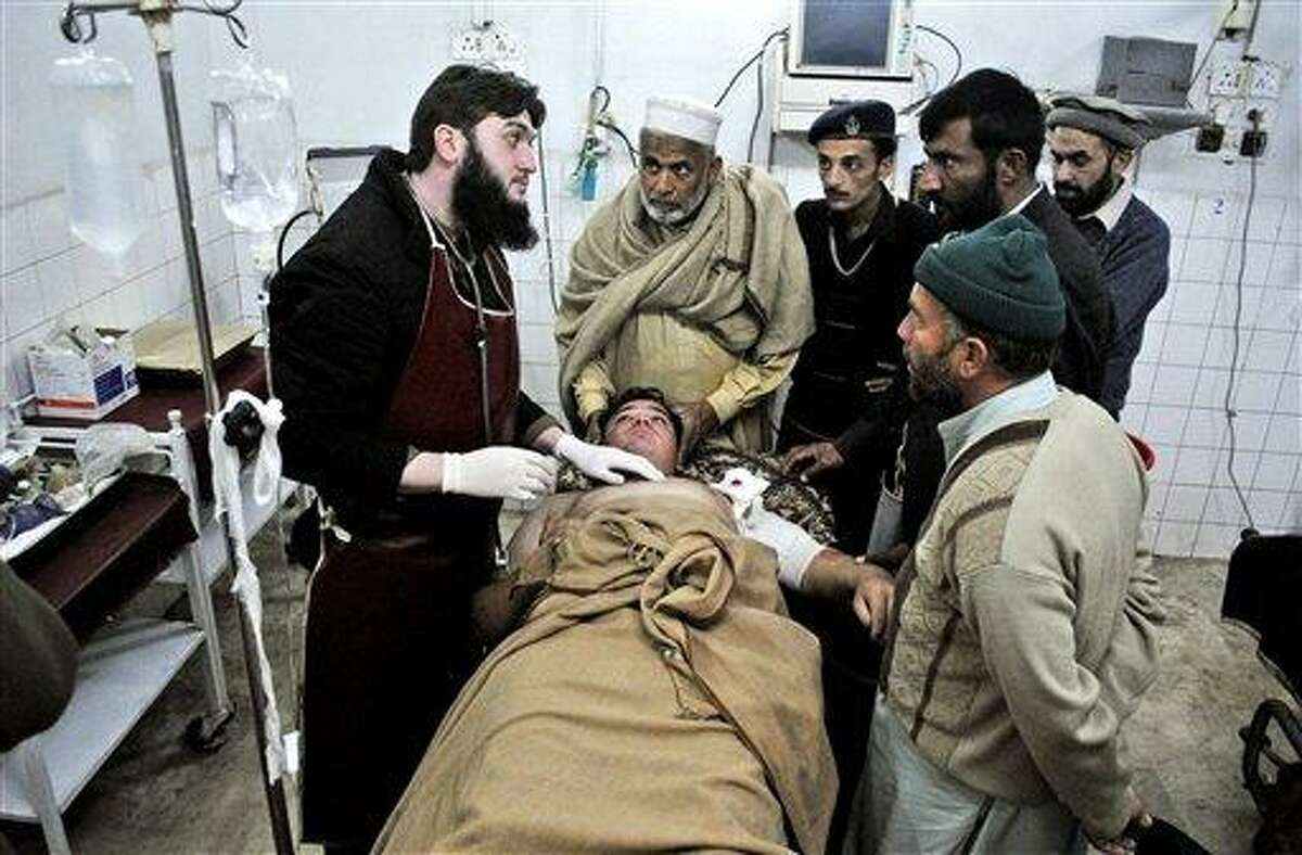 A Pakistani driver who survived an attack on a van which was targeted by gunmen in Swabi , lies at the Lady Reading Hospital bed after being admitted for treatment, in Peshawar, Pakistan, Tuesday, Jan. 1, 2013. Gunmen killed several female teachers and two other people on Tuesday in an ambush on a van carrying workers home from their jobs at a community center in northwest Pakistan, officials said. The attack was a reminder of the risks faced by educators and aid workers, especially women, in an area where Islamic militants often target women and girls trying to get an education or female teachers working with both genders. AP Photo/Mohammad Sajjad