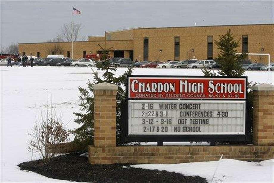 Students exit Chardon High School Monday in Chardon, Ohio. Associated Press Photo: ASSOCIATED PRESS / AP2012