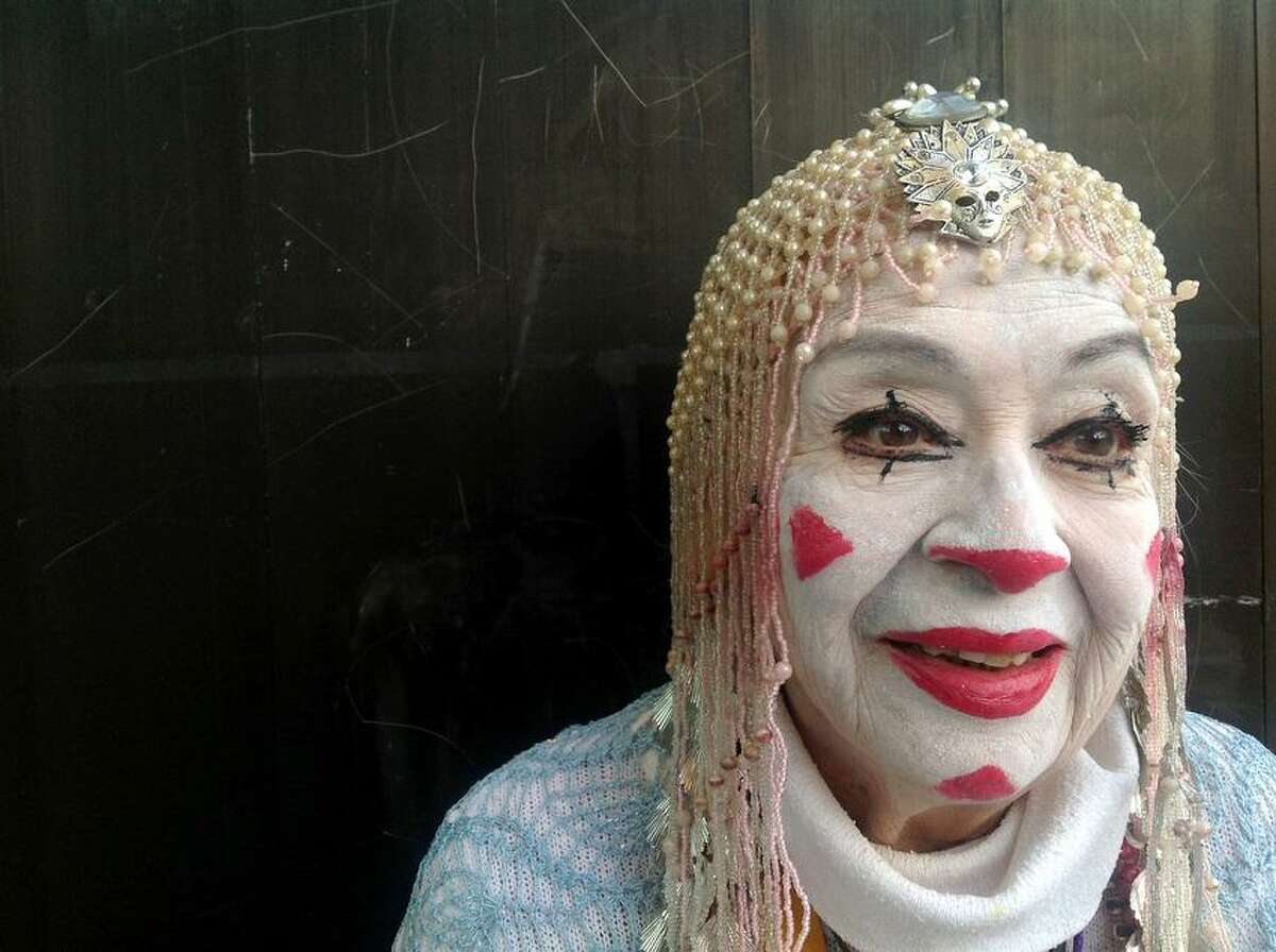 In this Tuesday, Oct. 23, 2012 photo, straight whiteface clown Tikitiki, 83, poses for a photo during Mexico's 17th annual clown convention, La Feria de la Risa, in Mexico City. Approximately 500 clowns gathered at two local theaters in the capital city to exchange ideas, compete for laughs and show off their comedy performances. (AP Photo/Anita Baca)