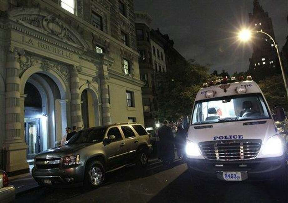 A police crime scene vehicle is parked in front of the luxury Manhattan apartment building where police say a nanny stabbed two small children to death in a bathtub and then stabbed herself in New York, Thursday, Oct. 25, 2012. Police say the children's mother found the scene after returning home with another child. (AP Photo/Kathy Willens) Photo: AP / AP