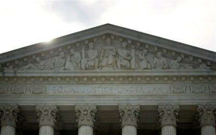 The Supreme Court in Washington, Monday, June 25, 2012. The Supreme Court is meeting Monday to issue opinions in some of the handful of cases that remain unresolved. (AP Photo/Evan Vucci)