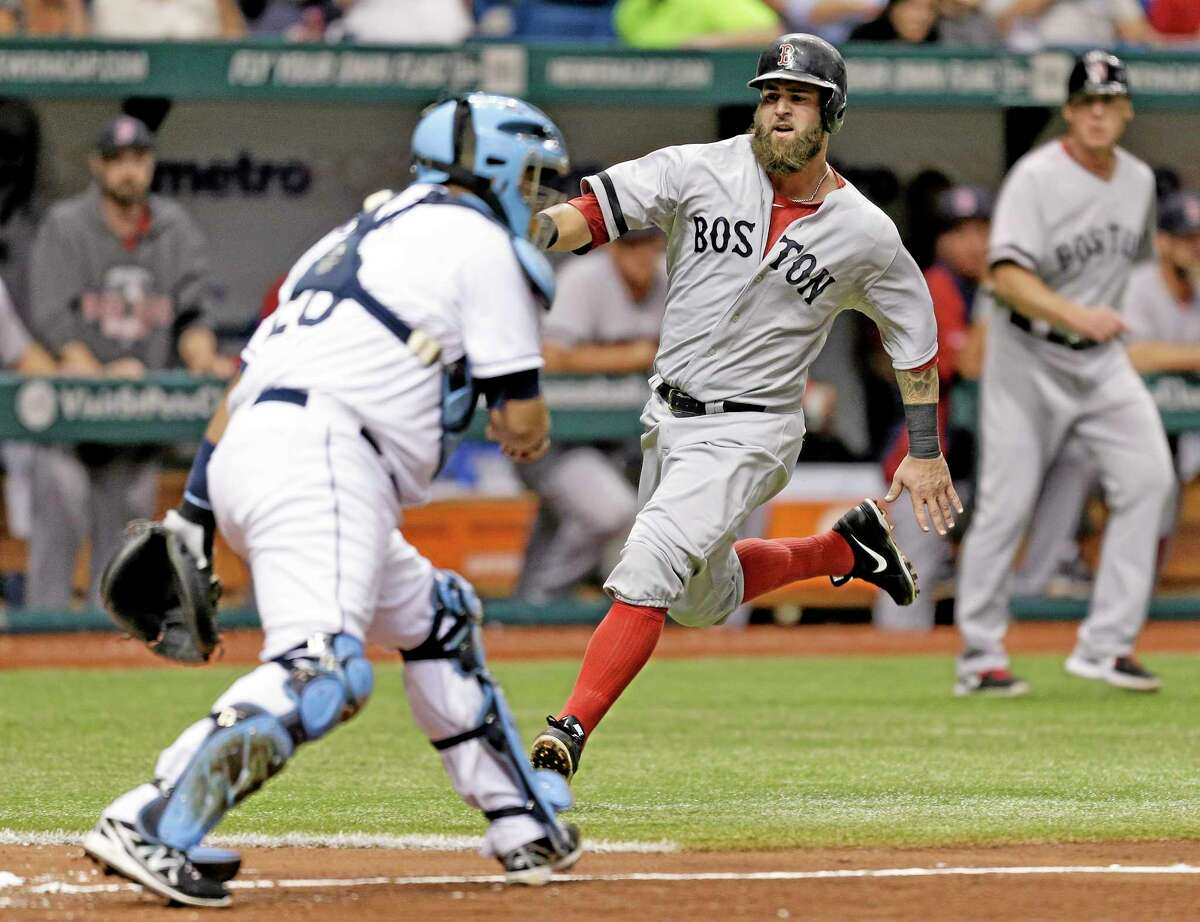 The Red Sox's Mike Napoli slides in with a run on an RBI single by Jonny Gomes in the fifth inning of Tuesday's 2-0 win over the Rays.