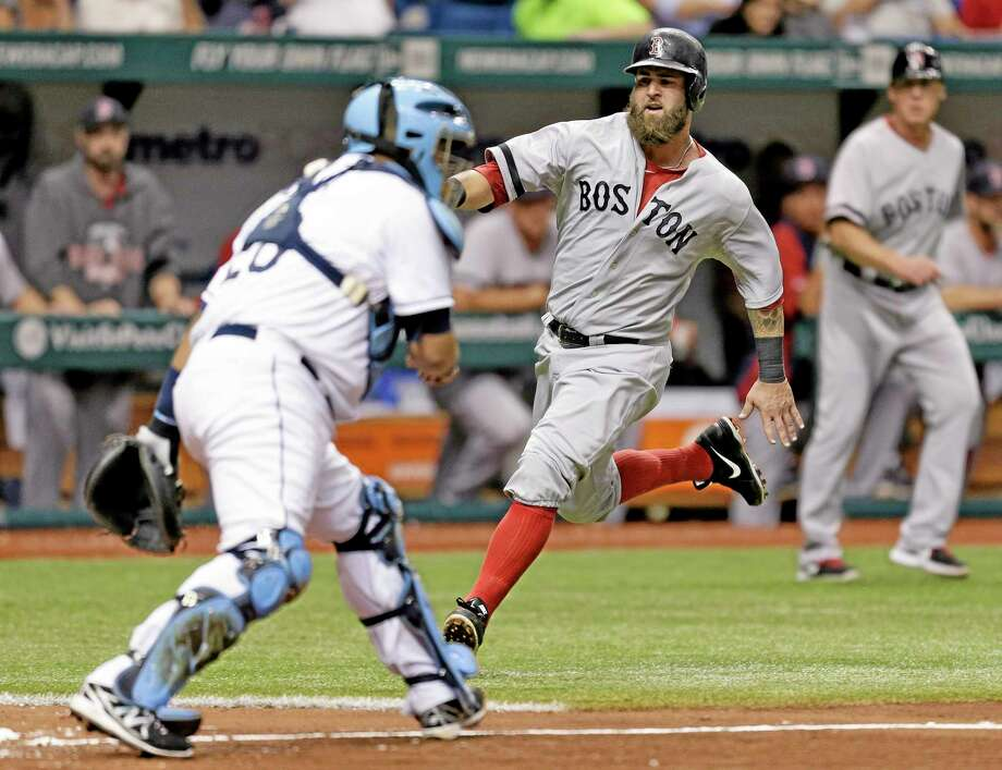 The Red Sox's Mike Napoli slides in with a run on an RBI single by Jonny Gomes in the fifth inning of Tuesday's 2-0 win over the Rays. Photo: Chris O'Meara — The Associated Press  / AP