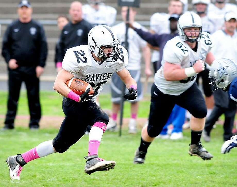 Kris Luster (left) of Xavier runs against Hillhouse in the first half on 10/26/2012.Photo by Arnold Gold/New Haven Register