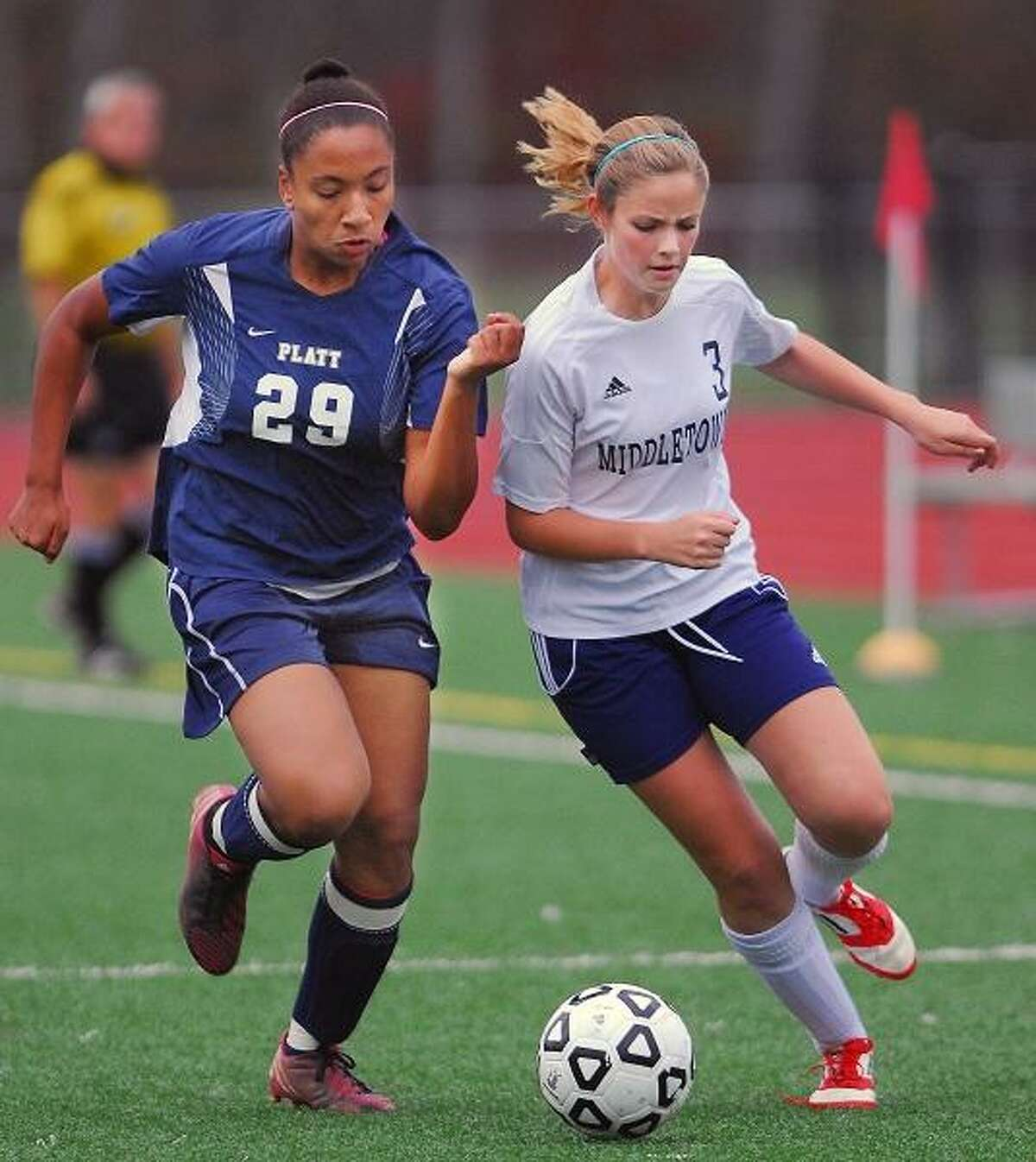 Catherine Avalone/The Middletown PressMiddletown senior Elizabeth Marx fights for posession with Platt freshman Hayley Dudley during a match Friday afternoon. The Blue Dragons defeated Platt 2-1 in overtime and remains undefeated 14-0-1.