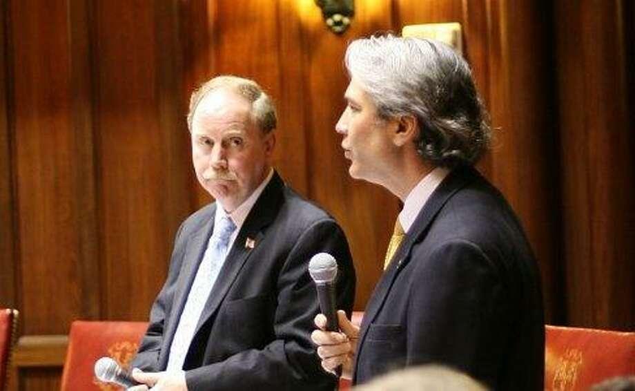 Sens. Anthony Musto and Michael McLachlan debate bill. Hugh McQuaid photo