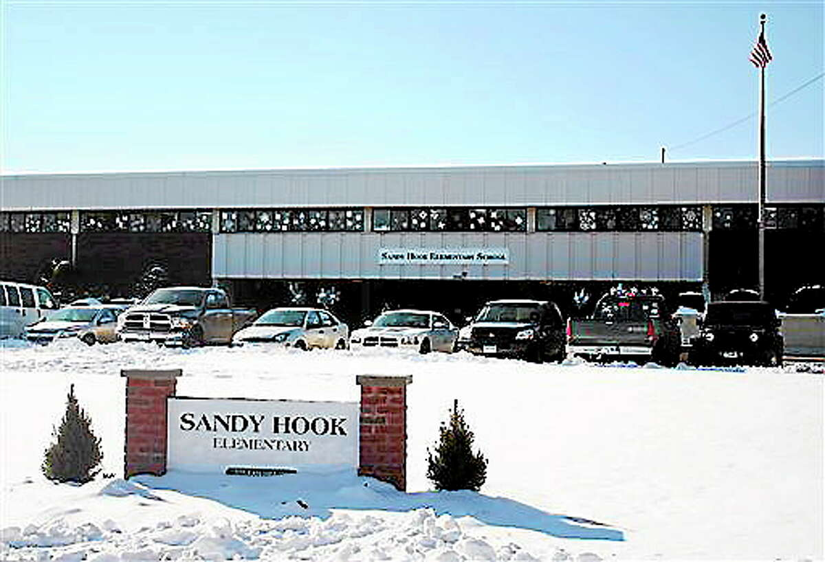 This photo, provided by the Monroe Police Department, shows the new Sandy Hook Elementary School on the first day of classes in Monroe, on Thursday, Jan. 3, 2013. The school, formerly known as Chalk Hill School, was overhauled especially for the students from the Sandy Hook School shooting in Newtown, in the neighboring town of Monroe. (AP Photo/Monroe Police Department)