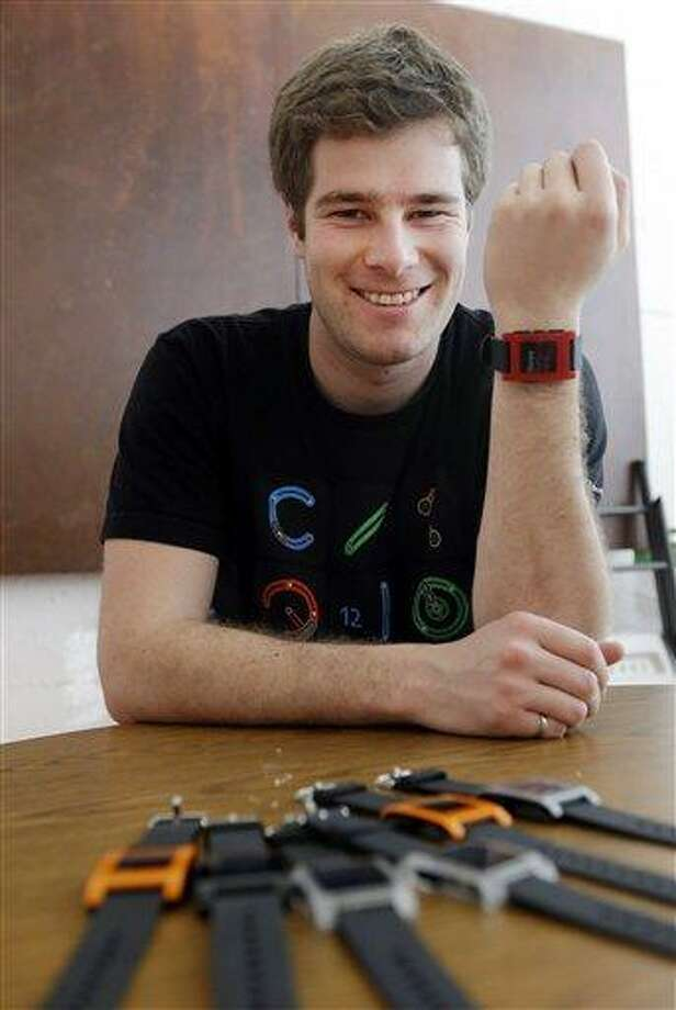 Eric Migicovsky, CEO of Pebble, displays his company's smart watch in Palo Alto, Calif., Tuesday, Feb. 12, 2013.  This new watch not only tells time, but also connects to smart phones within 10 meters. (AP Photo/Marcio Jose Sanchez) Photo: AP / AP