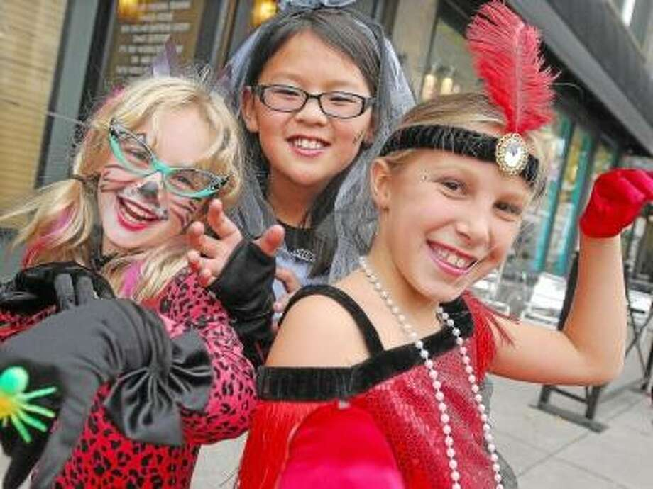 Catherine Avalone/The Middletown Press Arrie Langdon, 9, Mya Darrow, 9 and Taressa Sczewczyk Trick or Treat on Main Street Friday afternoon.