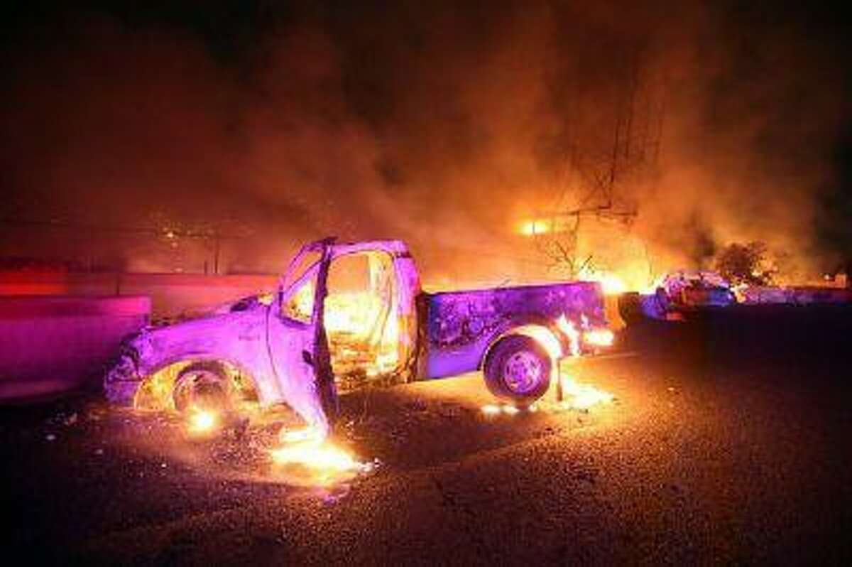 Burned cars are pictured in a highway in Ecatepec near Mexico city, on May 7, 2013. A gas tanker exploded in a Mexico City suburb on Tuesday, killing at least 18 people and damaging several homes and cars, an official said. (Victor Rojas/AFP/Getty Images)