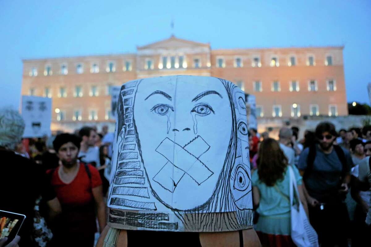 Art teachers protest against the government austerity measure that threaten their jobs, outside the Greek parliament in central Athens, on Friday, Sept, 6, 2013. The conservative-led government plans to sack 15,000 state employees by the end of 2014, and place another 25,000 in a program of mandatory suspensions and job transfers. (AP Photo/Petros Giannakouris)