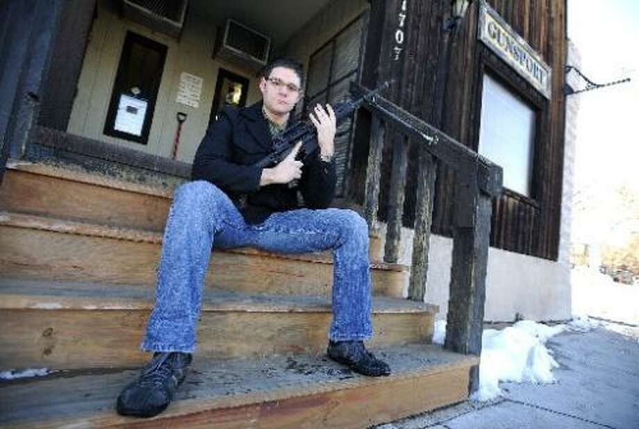 Marine veteran Savant Suykerbuyk holds his unloaded AR-15 outside of Boulder Gunsport on Wednesday. (Jeremy Papasso/Boulder Daily Camera) Photo: DC / (C) 2012 Boulder Daily Camera, Media News Group, Prairie Mountain Publishing www.dailycamera.com www.buffzone.com www.coloradoda