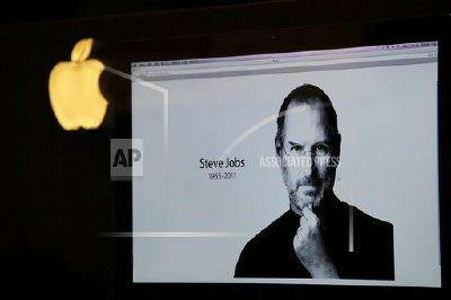 An iMac computer shows the image of Apple co-founder Steve Jobs, who died in 2011 at the age of 56.