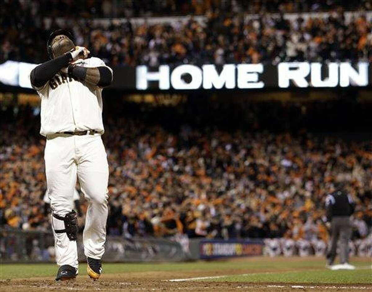 San Francisco Giants' Pablo Sandoval reacts at home after hitting his third home run of the game during the fifth inning of Game 1 of baseball's World Series against the Detroit Tigers Wednesday, Oct. 24, 2012, in San Francisco. (AP Photo/David J. Phillip)