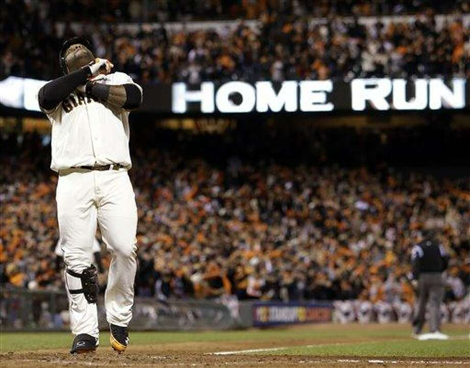 San Francisco Giants' Pablo Sandoval reacts at home after hitting his third home run of the game during the fifth inning of Game 1 of baseball's World Series against the Detroit Tigers Wednesday, Oct. 24, 2012, in San Francisco. (AP Photo/David J. Phillip) Photo: ASSOCIATED PRESS / AP2012