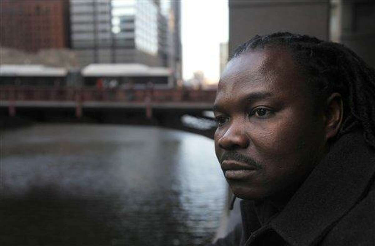 Nigerian-born Charles Wiwa, 44, poses for a portrait in Chicago. Wiwa, fled Nigeria in 1996 following a crackdown on protests against Shell's oil operations in the Niger Delta. He and other natives of the oil-rich Ogoni region claim Shell was eager to stop protests in the area and was complicit in Nigerian government actions that included fatal shootings, rapes, beatings, arrests and property destruction. He said an American court is the only place the Ogonis can seek accountability. Associated Press