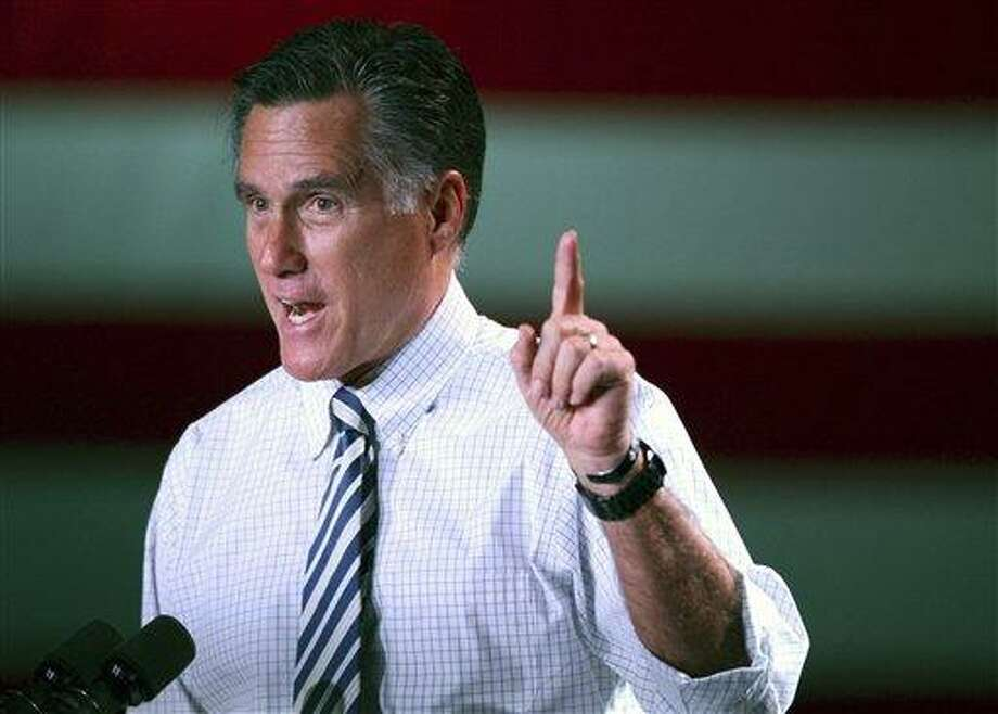 Republican presidential candidate, former Massachusetts Gov. Mitt Romney speaks as he campaigns in Reno, Nev. Wednesday. AP Photo/Cathleen Allison Photo: AP / FR70203 AP