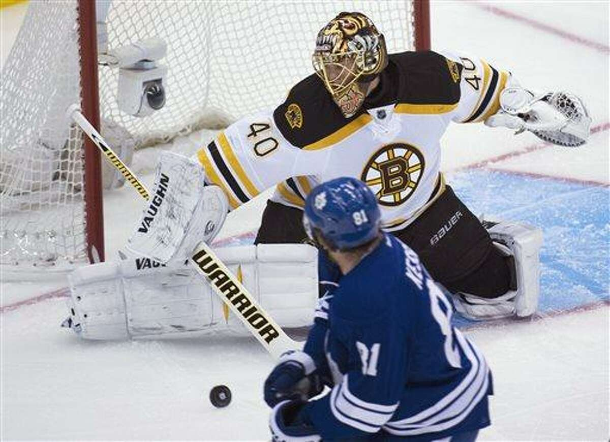 Toronto Maple Leafs forward Phil Kessel, front, gets stopped by Boston Bruins goalie Tuukka Rask during the first period of Game 3 of their first-round NHL hockey Stanley Cup playoff series, Monday, May 6, 2013, in Toronto. (AP Photo/The Canadian Press, Nathan Denette)