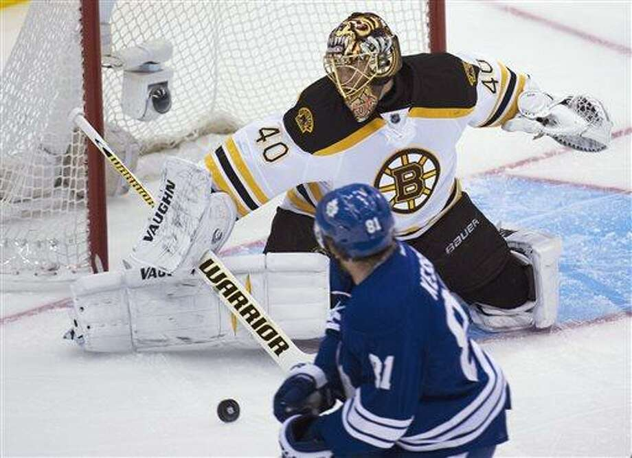 Toronto Maple Leafs forward Phil Kessel, front, gets stopped by Boston Bruins goalie Tuukka Rask during the first period of Game 3 of their first-round NHL hockey Stanley Cup playoff series, Monday, May 6, 2013, in Toronto. (AP Photo/The Canadian Press, Nathan Denette) Photo: AP / The Canadian Press