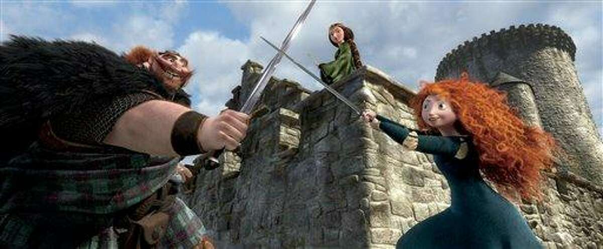 """This film image released by Disney/Pixar shows characters, from left, King Fergus, voiced by Billy Connolly, Queen Elinor, voiced by Emma Thompson and Merida, voiced by Kelly Macdonald, in a scene from """"Brave."""" Associated Press"""