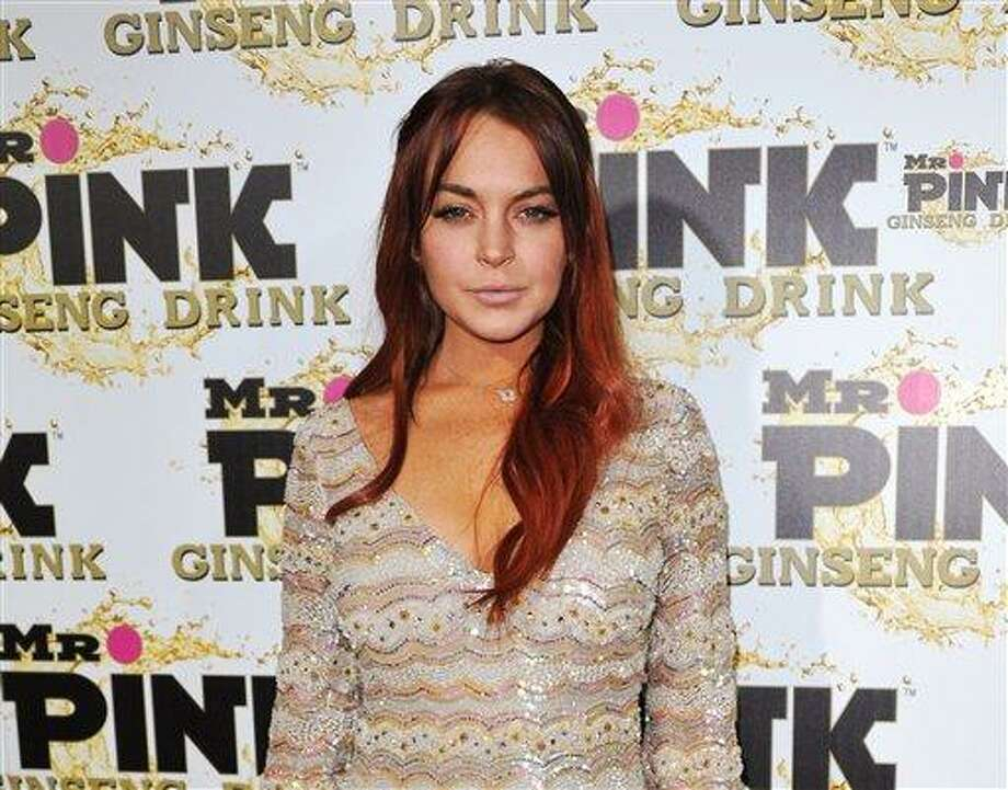 FILE - In this Oct. 11, 2012 file photo, Lindsay Lohan attends the Mr. Pink Ginseng launch party at the Beverly Wilshire hotel in Beverly Hills, Calif.  Lohan's attorney wrote in a letter filed in court on Feb. 22, 2013, that the  actress is willing to record public service announcements and provide inspirational talks at schools and hospitals as a possible way to resolve a case that alleges she lied to police about a car accident. (Photo by Richard Shotwell/Invision/AP, File) Photo: Richard Shotwell/Invision/AP / Invision