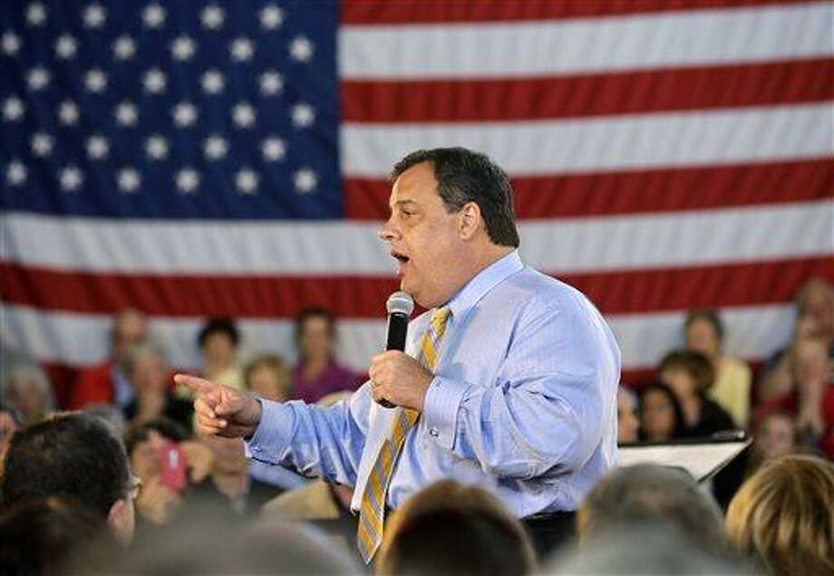 FILE - New Jersey Gov. Chris Christie answers a question in this April 30, 2013 file photo taken in Long Beach Township, N.J., during a town hall meeting. Christie secretly underwent gastric band surgery in February to try to lose weight at the urging of his family. Christie told The New York Post for a story in Tuesday's May 7, 2013 edition. (AP Photo/Mel Evans, File) Photo: AP / AP