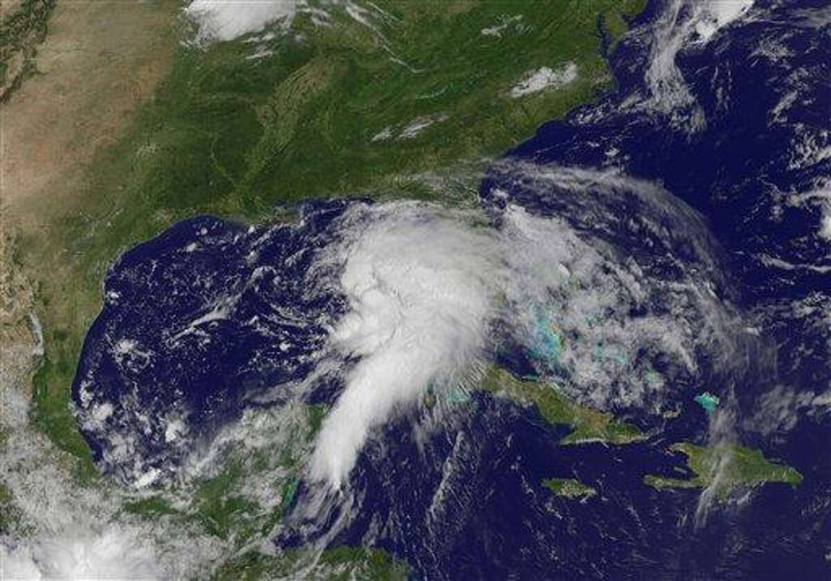 This NOAA satellite image taken Saturday shows shower and thunderstorm activity developing around an area of low pressure spinning in the Gulf of Mexico. Tropical Storm Debby has formed in the Gulf of Mexico and forecasters say it will bring rain to the Gulf coast from southern Louisiana to the Florida Panhandle. Associated Press