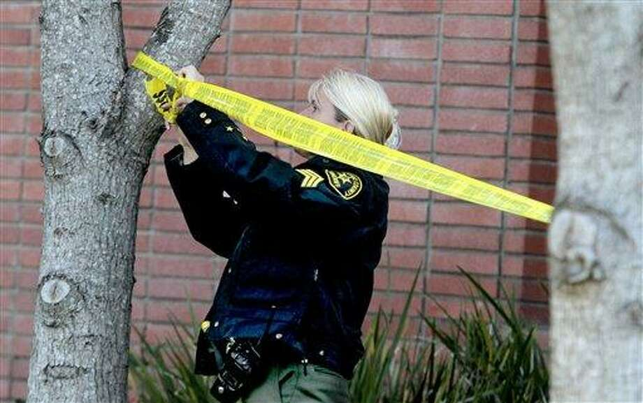 A Santa Cruz County Sheriffs sergeant tapes off an area on a North Branciforte Avenue property near the spot where Jeremy Goulet allegedly murdered Santa Cruz Police detectives Elizabeth Butler and Loran 'Butch Baker on Tuesday in Santa Cruz, Calif., on Wednesday, Feb. 27, 2013. (AP Photo/Santa Cruz Sentinel, Shmuel Thaler) Photo: AP / Santa Cruz Sentinel