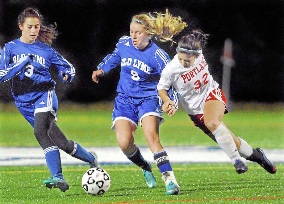 Portland senior forward Jackie Otake battles Lyme-Old Lyme in last year's Shoreline Championship game. The Highlanders won 2-1 at Indian River Athletic Complex in Clinton. Photo:  Catherine Avalone — The Middletown Press