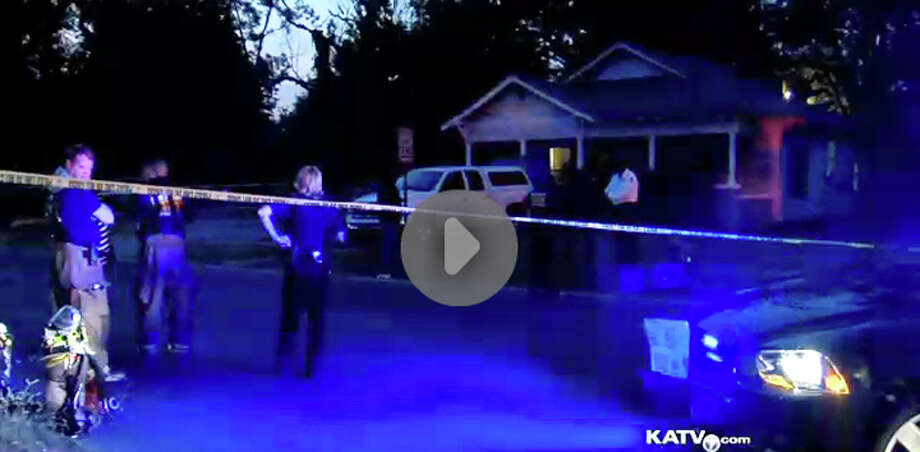 In an image made from video provided by KATV, police surround a home in Pine Bluff, Ark., Saturday, Sept. 7, 2013 during a standoff that left an elderly man dead. Lt. David Price told KATV that when officers arrived at the home they learned that an aggravated assault had occurred against two people. Arkansas SWAT officers shot and killed the suspect, Monroe Isadore, who authorities say is 107-year-old old, when he pointed a weapon at them. (AP Photo/courtesy of KATV) Photo: AP / KATV