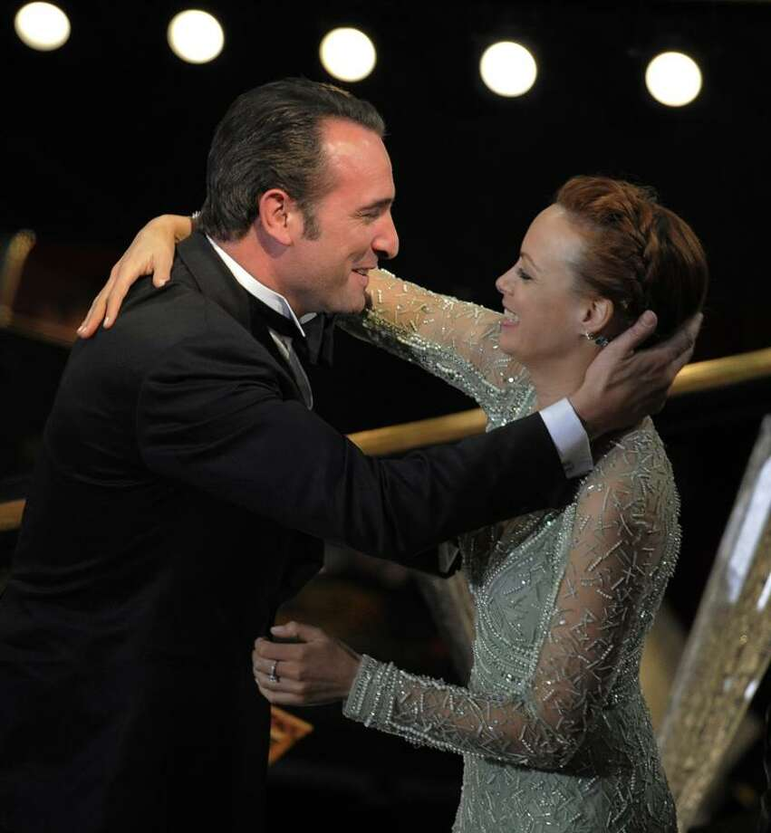 """Jean Dujardin is congratulated by Berenice Bejo before accepting the Oscar for best actor in a leading role for """"The Artist"""" during the 84th Academy Awards on Sunday in the Hollywood section of Los Angeles. Associated Press Photo: AP / AP2012"""