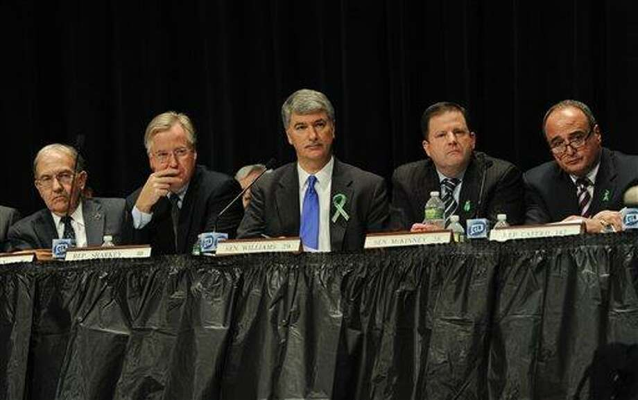 From the left, Connecticut State Senate Majority Leader Martin Looney, Speaker of the House Brendan Sharkey, Senate President Donald Williams Jr.,  State Senate minority leader John McKinney, and House minority leader Lawrence Cafero, listen to residents of Newtown testify during a hearing of a legislative task force on gun violence and children's safety at Newtown High School in Newtown, Conn., Wednesday, Jan. 30, 2013. Connecticut lawmakers are in Newtown for the hearing, where those invited to give testimony include first responders and families with children enrolled at Sandy Hook Elementary. (AP Photo/Jessica Hill) Photo: ASSOCIATED PRESS / A2013