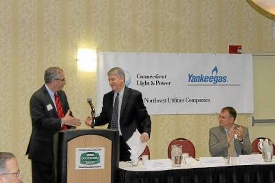 John M. Ferrantino, Director, Meter Service, The Connecticut Light & Power Company, introduces Senate President Don Williams at a Special Chamber Legislative Event on Friday, April 26, 2013.  Rick Parmelee of BlumShapiro, who serves as Co-Chair of the Chamber's Legislative Committee, looks on.