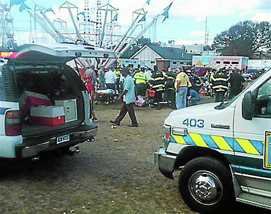 An amusement park ride malfunctioned Sunday Sept. 8, 2013 at the Norwalk Oyster Festival. Thirteen children were injured when a festival attraction that swings riders into the air lost power at a community fair in Connecticut but none of the injuries appeared to be life-threatening, authorities said. Most of the children suffered minor injuries and were treated at the Oyster Festival in Norwalk, police said. Norwalk Police Chief Thomas Kulhawik said there were initial reports of serious injuries but preliminary indications are that the injuries were not as severe as first feared. (AP Photo/ The Connecticut Post, David Wells) Photo: AP / The Connecticut Post