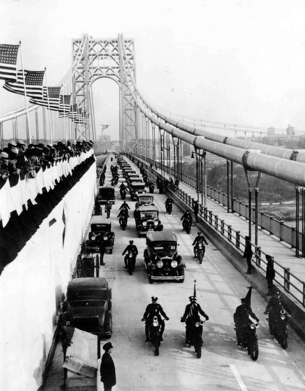 Official motorcades start across the George Washington Bridge during the dedication ceremonies in New York City on Oct. 24, 1931. The world's longest suspension bridge, costing $60 million, links New York with New Jersey. (AP Photo)