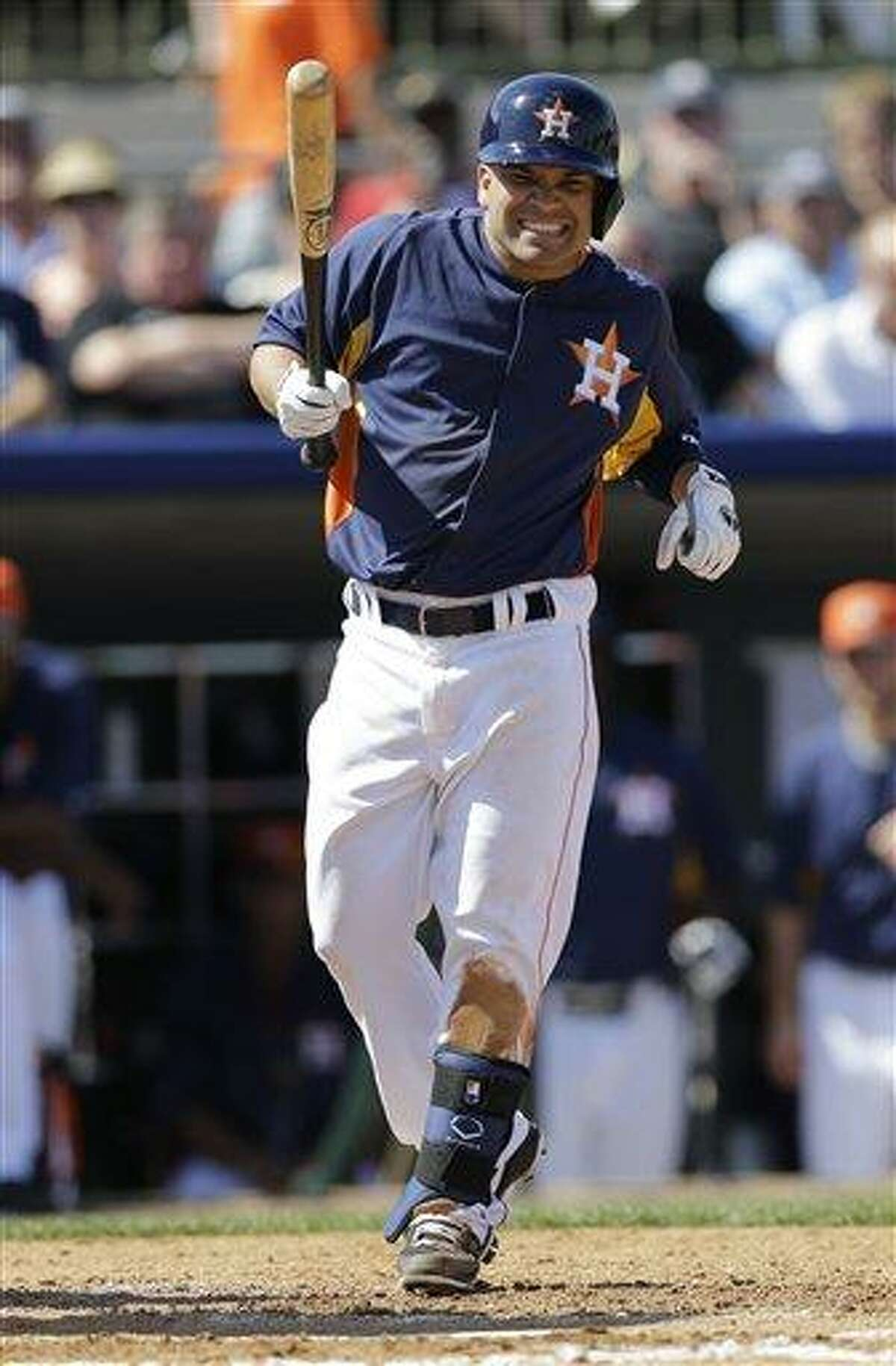 Houston Astros' Jose Altuve reacts after being hit by a pitch during the fourth inning of an exhibition spring training baseball game against the New York Yankees Thursday, Feb. 28, 2013, in Kissimmee, Fla. (AP Photo/David J. Phillip)