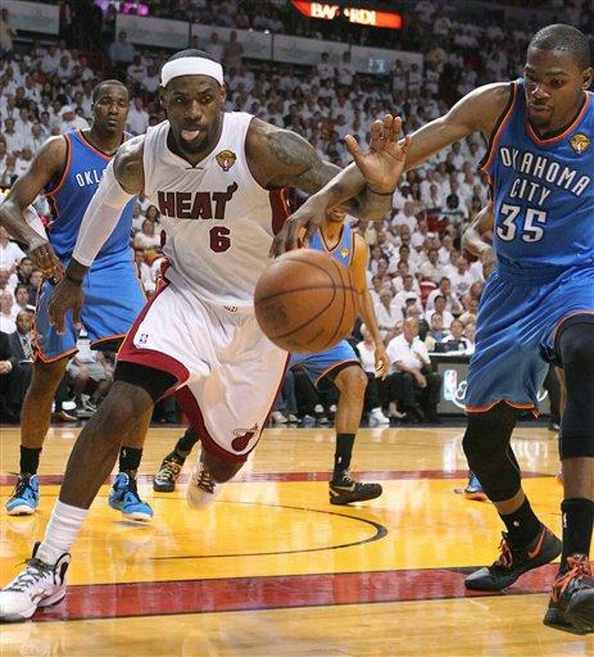LeBron James battle for a lose ball against Kevin Durant during the third quarter of game 5 of the NBA Finals between the Oklahoma City Thunder against Miami Heat Thrusday at the AmericanAirlines Arena in Miami. Associated Press