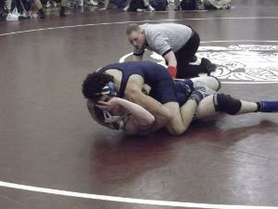 Middletown Press file art Middletown All-American Devon Carrillo, shown during the Class L championships last weekend in this photo, won the State Open title at 182 pounds on Saturday in New Haven. Xavier took the team State Open championship.