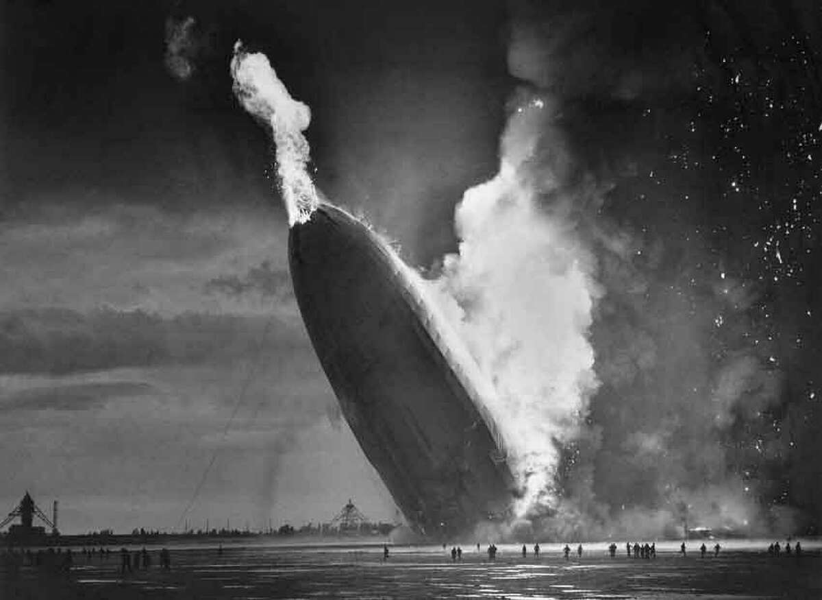 The German dirigible Hindenburg crashes to earth, tail first, in flaming ruins after exploding on May 6, 1937, at the U.S. Naval Station in Lakehurst, N.J. The 1920s and 1930s were the golden age of dirigibles which crossed the Atlantic Ocean in about three days -- faster than a ship. The Hindenburg was the largest airship ever built at 804 feet long and flew up to 85 miles per hour while held aloft by hydrogen, which was highly flammable. The disaster, which killed 36 people after a 60-hour transatlantic flight from Germany, ended regular passenger service by the lighter-than-air airships. (AP Photo/Murray Becker)