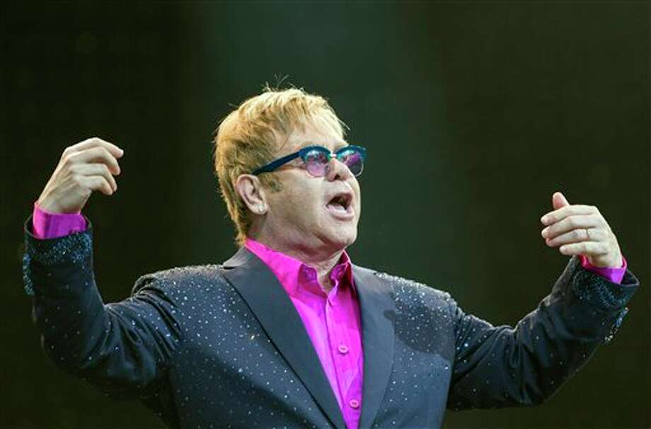 In this picture made available Friday, Sept. 6, 2013, Sir Elton John performs on the Waldbuehne stage in Berlin, Germany, Thursday, Sept. 5, 2013. British musician John gives five concerts in Germany during his 'Greatest Hits Live Tour 2013'. (AP Photo/dpa, Florian Schuh) Photo: AP / dpa