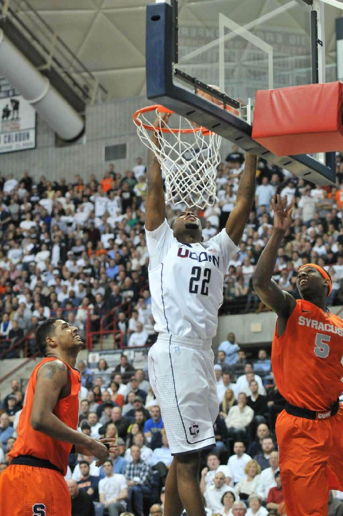 ASSOCIATED PRESS Connecticut forward Roscoe Smith gets fouled by Syracuse forward C.J. Fair in the first half of Saturday's game at Gampel Pavilion in Storrs.