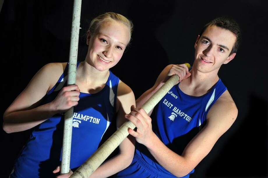 """Catherine Avalone/The Middletown Press East Hampton senior pole vaulters Amber Sekoll and Tyler Rubega. Sekoll, seeded at 10' 6"""" placed second with a jump of 10' and Rubega, seeded at 13' 3"""" won the title at 12' 6""""  in the CIAC Class S Indoor Track State Championship at the Floyd Little Athletic Center in New Haven on February 14. / TheMiddletownPress"""